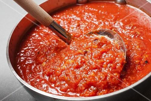 Pot of Basic Tomato Sauce with Ladle