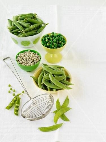 An arrangement of peas (fresh, dried, pods)