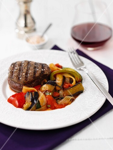 A beef medallion with aubergine ratatouille