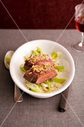 Duck breast on a bed of leeks