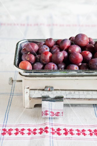 Plums on an old pair of kitchen scales