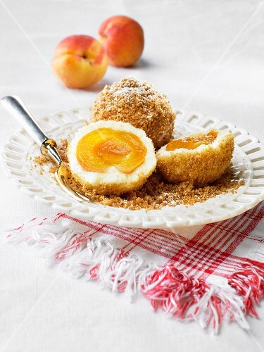 Apricot dumplings with icing sugar