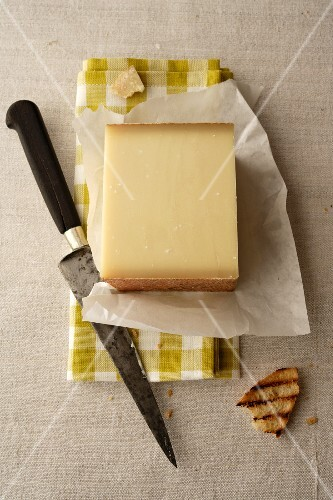 A piece of Gruyere on paper