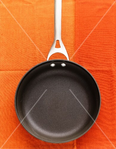 An empty frying pan, seen from above
