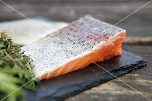 Salmon fillet on a slate tile