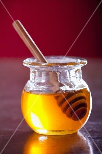 Jar of honey with honey dipper