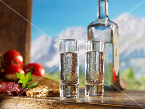 Two glasses of schnapps for supper against a alpine backdrop