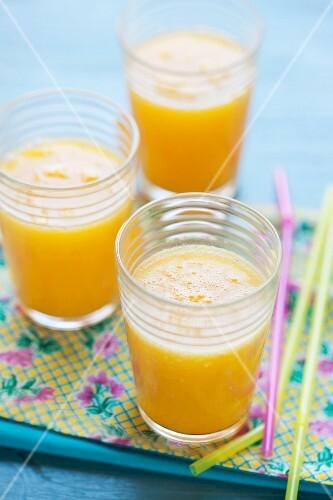 Three smoothies (mango, orange, passion fruit)