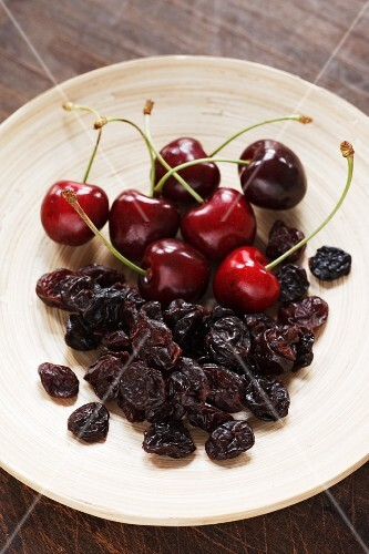 A plate of fresh and dried cherries