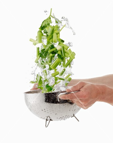 Washing celery in a colander