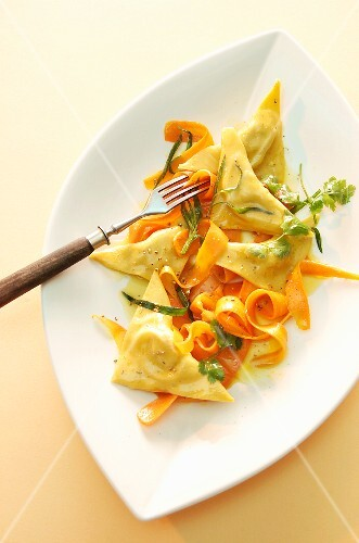 Rabbit-filled ravioli and grated carrot