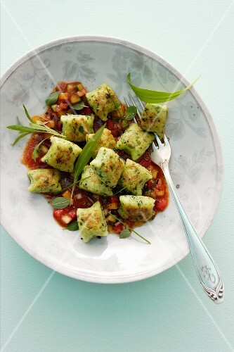 Herb gnocchi with vegetable sauce