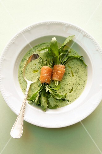 Rocket soup with salmon rolls