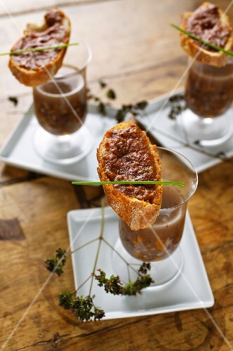 Clear venison soup with spicy venison pate crostini