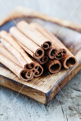 Cinnamon in a brown wooden bowl