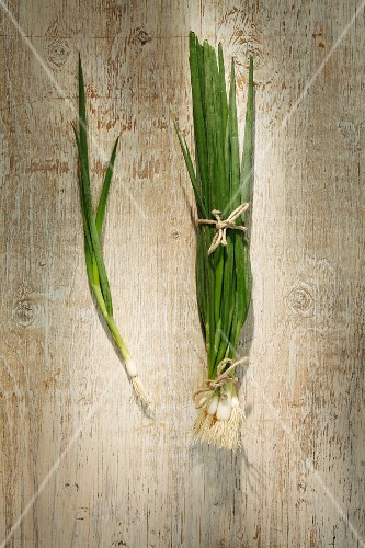 Spring onions on a wooden surface