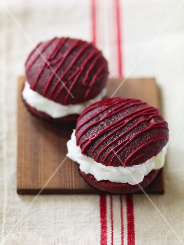 Two Red Velvet Whoopie Pies on a Board