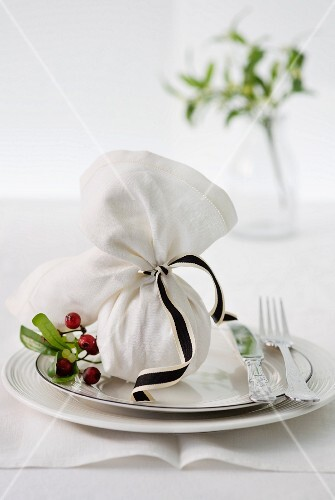 Christmas pudding wrapped in napkin as a party favour