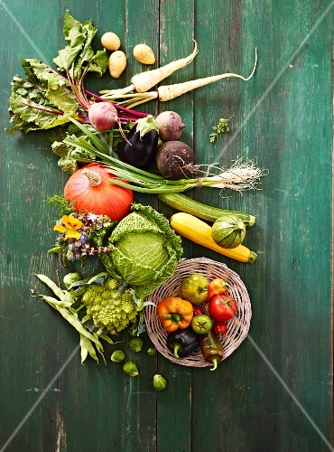 Various vegetables on a green wooden surface