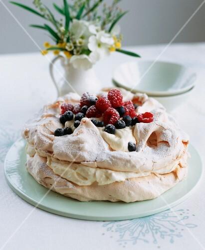 Pavlova with lemon cream and fresh berries