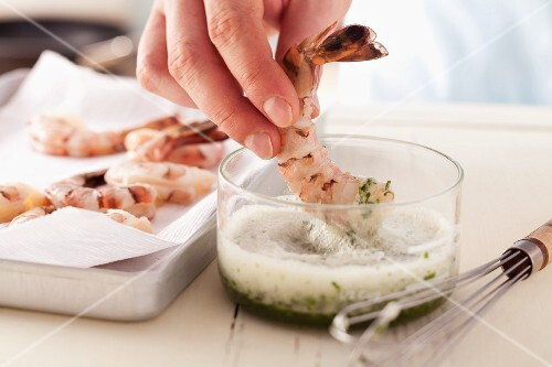 Dipping prawns in mixture of herbs and egg white