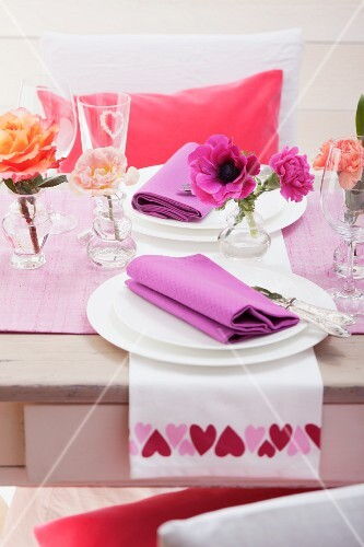 Festive table for two with various flowers