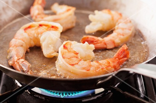 King prawns being fried