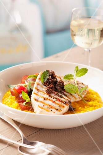 Grilled sword fish with tapenade on saffron risotto