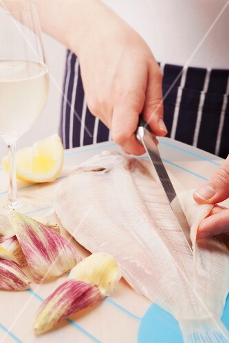 Sole being filleted