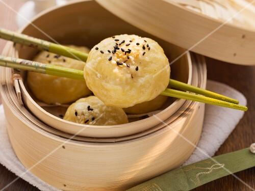 Chinese stuffed yeast dumplings in bamboo steamer