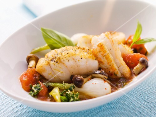 Monkfish and langoustine with tomatoes and spring onions