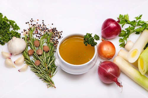 Soup bowl of vegetable stock and ingredients