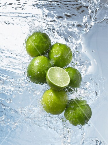 Limes, whole & halved, in water