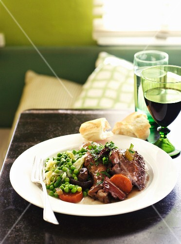 A plate of coq au vin