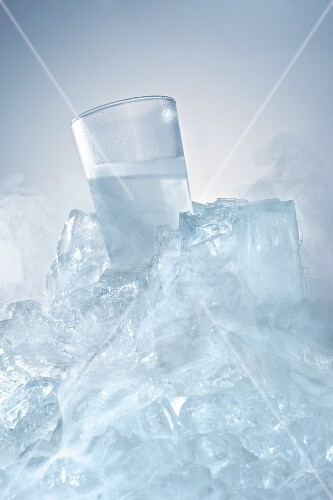 Vodka glass in a block of ice