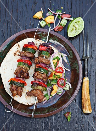 Grilled pork kebabs with zucchini and peppers