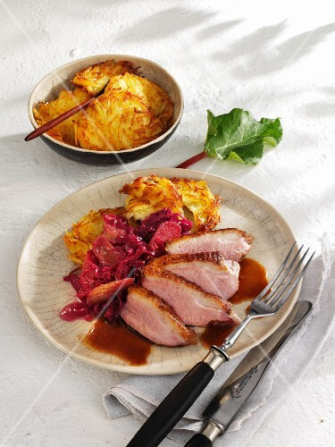 Roast duck with rhubarb-red cabbage and hash browns