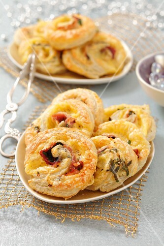 Puff pastry spirals with ham and cheese for Christmas