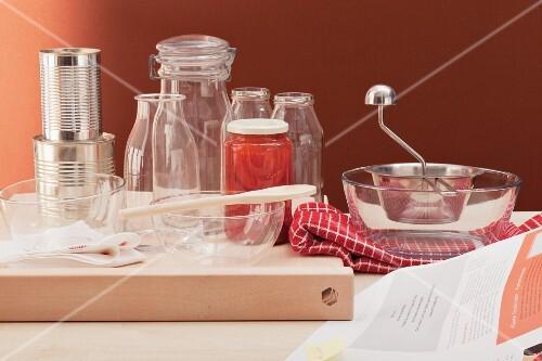Empty bowls, preserving jars, tins and a puree maker