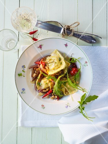 Tortelli with onion and pine nut butter and fresh rocket