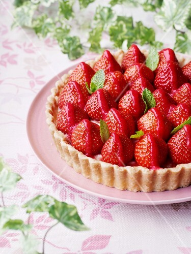 Strawberry tart with mint leaves