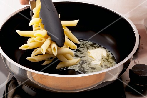 Pasta being fried in butter