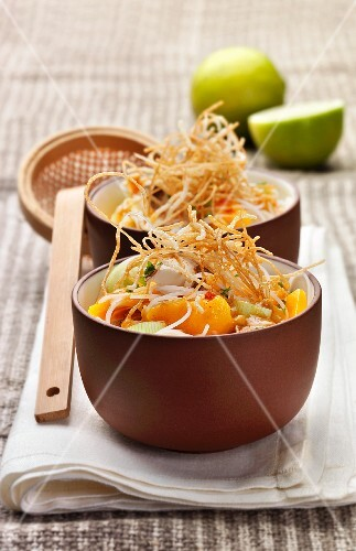 Chinese noodle soup with rice noodles, onion, mango and fried noodles