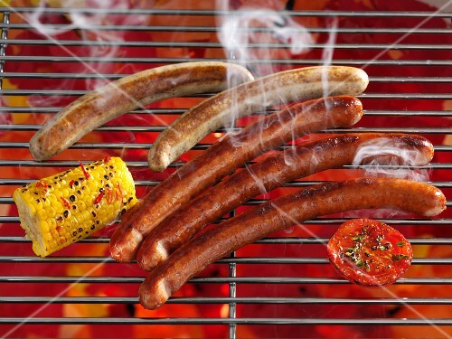 Smoking sausages on a grill