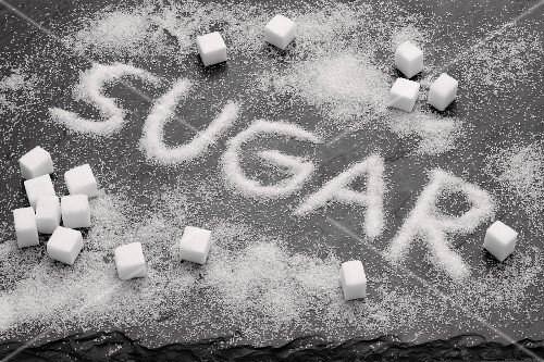 The word SUGAR written in sugar