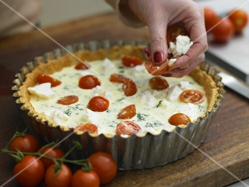 Tomato quiche being made