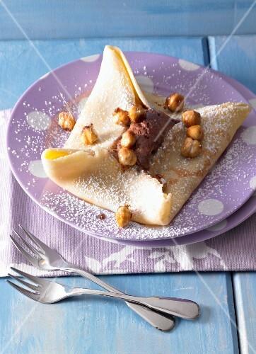 Pancakes with mousse au chocolat and caramelised hazelnuts