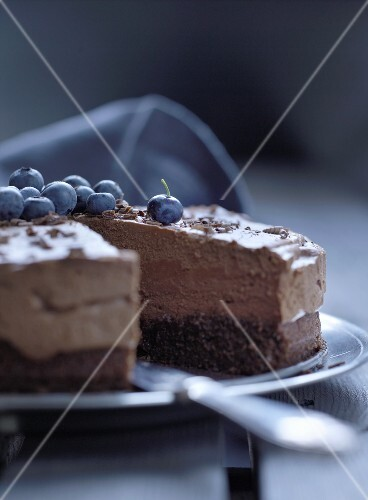 Chocolate cream cake with blueberries