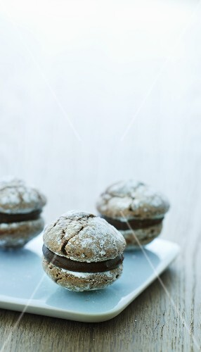 Nut biscuits filled with chocolate cream