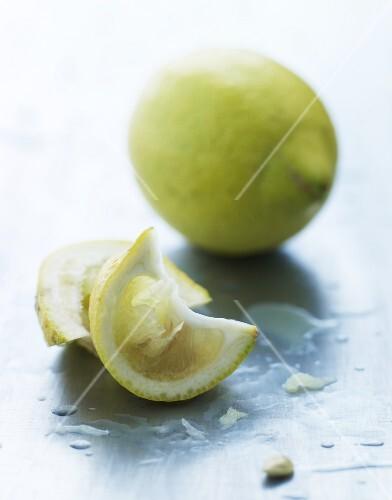 Lemon wedges and a whole lemon